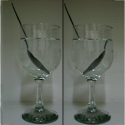 Negative refraction. The picture on the left shows how a spoon in a glass of water appears to break at the air-water interface, and then continues inside the liquid slightly shifted to one side, but still keeping the same orientation as in air — left-to-right in this case. This optical illusion is due to the fact that the refractive index of water is different from the one of air — still positive though, as in any other natural material. On the right, there is a basic illustration of what would happen by filling the glass with a liquid with a negative index of refraction: the orientation of the spoon inside the liquid would appear to be diametrically opposite to the spoon in the air, namely right-to-left instead of left-to-right.