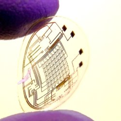 A contact lens with integrated circuitry. A researcher of the University of Washington holds a contact lens which embeds LEDs and other electrical components and which is manufactured using their newly developed self-assembly technique.